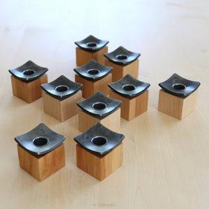 Kynttilänjalka puuta ja takorautaa, design: Tuuli Autio